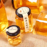 Wholesale Hexagon Clear Glass Storage Bottle 100ml 500ml With Metal Lid For Honey Cream from china suppliers