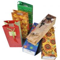 Wholesale UV Stamping Emboss 200g Art Paper Gift Bags With Die-Cut / Patch Handle from china suppliers