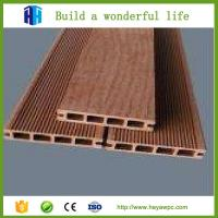 Wholesale Chinaheya hollow design wpc wood plastic flooring lumber price list from china suppliers