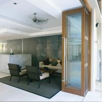 China Exterior Tempered Folding Glass Door Replacement Powder Coating 6063 Aluminum on sale