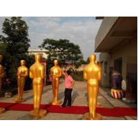 Wholesale life size Oscar statue/sculpture for sale with golden color fiberglass as hotel mall door deco from china suppliers
