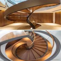 Wholesale Decorative stainless steel beam closed riser interior round curved stairs with glass railing from china suppliers