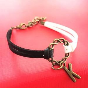 China Black white color bracelet ,handmade PU leather bracelet ,alphabet charms bracelet on sale