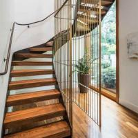 Wholesale High safety indoor Curved stairs residential stainless steel wooden curved staircase from china suppliers